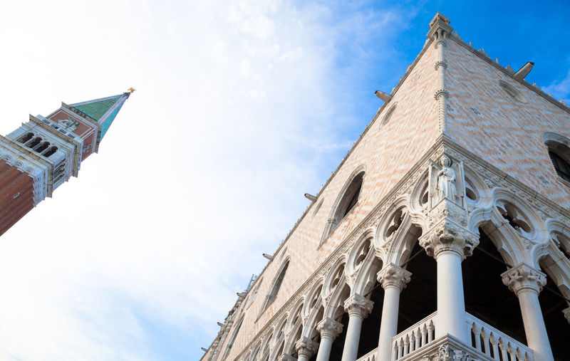 Low angle view of san marco campanile bell tower against sky