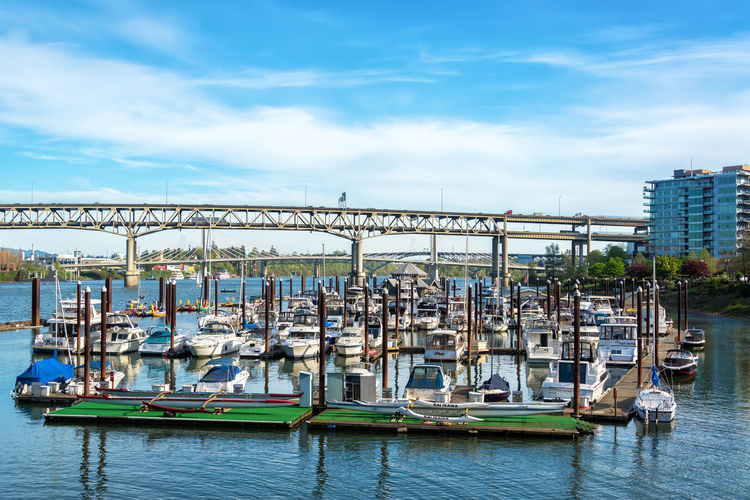 PORTLAND, OR - APRIL 8: Riverplace Marina in downtown Portland, OR on April 8, 2016 Architecture Bridge Bridge - Man Made Structure Built Structure City Day Downtown Marina Oregon Outdoors Pacific Northwest  Portland River Riverplace Riverplace Marina Sky Tourism Travel Travel Destinations Urban USA Water Waterfront Willamette Willamette River