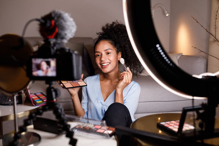 Vlogger Indoors  Home Smiling One Person Indoors  Hairstyle Happiness Cheerful Skin Care Pallette Cosmetic Looking DSLR Ring Light Filming Content Sitting Blogger Beauty In Nature Product Influencer