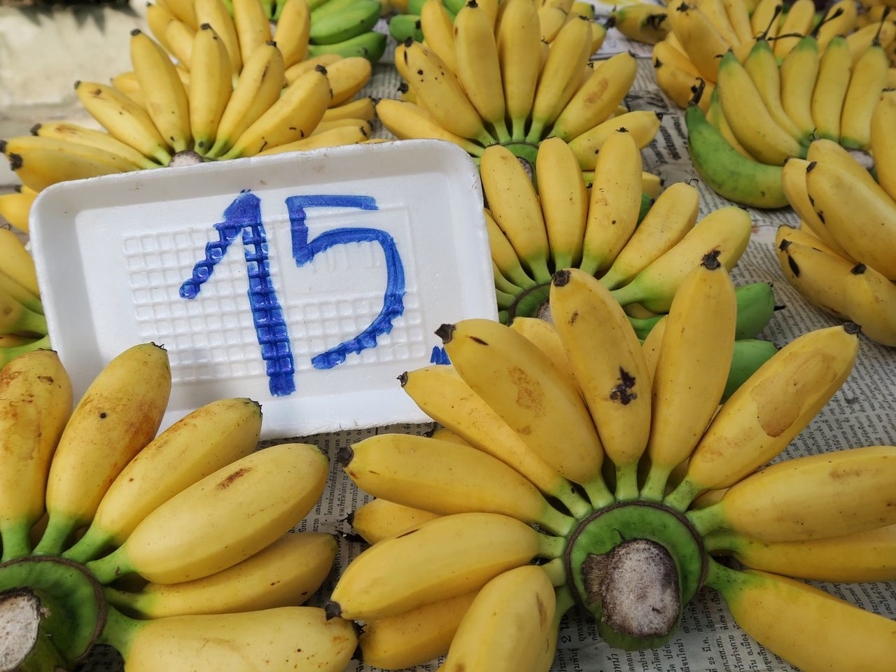 banana, fruit, food and drink, food, for sale, yellow, healthy eating, market, freshness, market stall, retail, text, no people, high angle view, choice, day, close-up, outdoors
