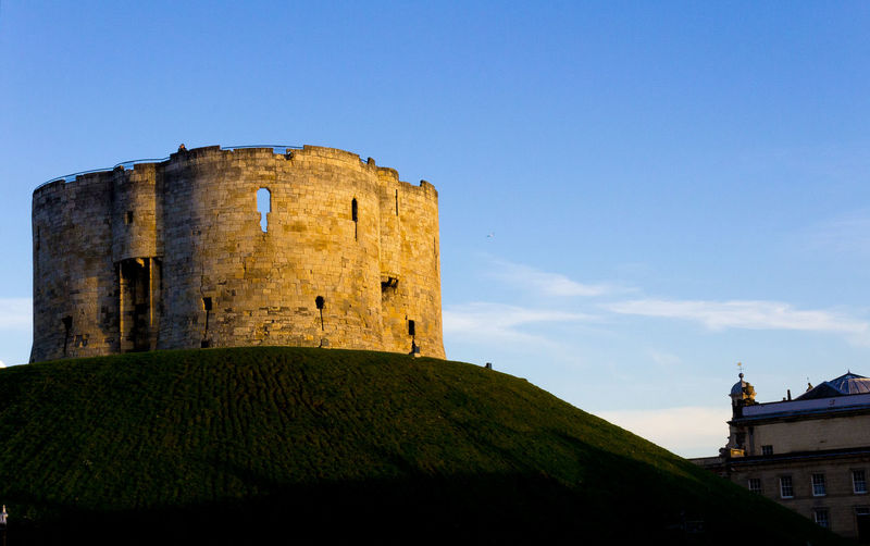 Low angle view of fort against blue sky