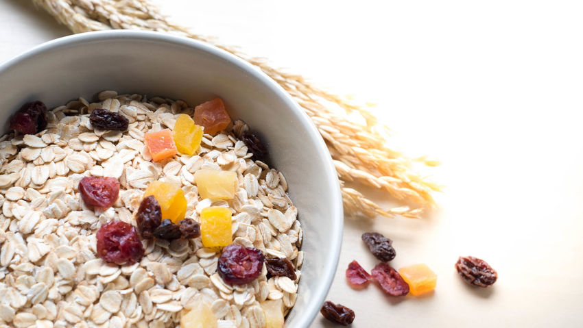 Bowl Breakfast Breakfast Cereal Close-up Dietary Fiber Dried Food Food Food And Drink Freshness Fruit Granola Healthy Eating Indoors  Kitchen Utensil Meal No People Oatmeal Oats - Food Raisin Seed Spoon Studio Shot Wellbeing White Background
