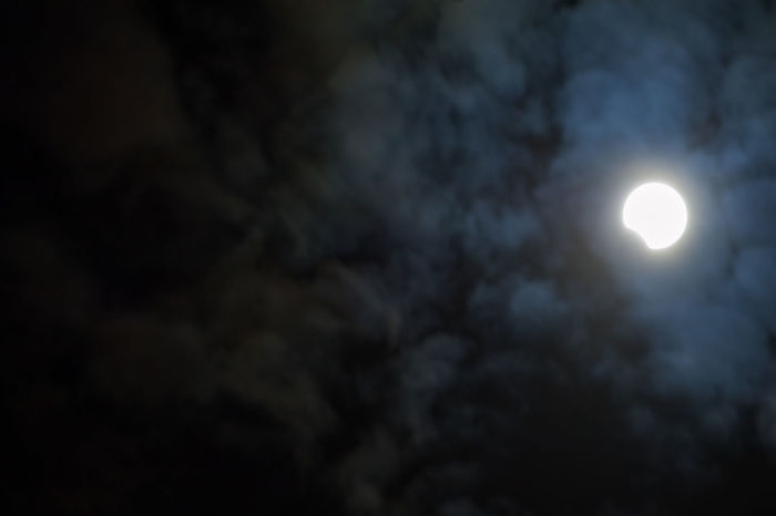 View of the sun against a dark cloudy sky during the solar eclipse in 2017 Copy Space Dark Sky Partial Eclipse Solar Eclipse 2017 Cloud - Sky Clouds Illuminated Low Angle View Mysterious Mystery Natural Phenomenon Nature No People Outdoors Partial Solar Eclipse Sky Solar Eclipse Sun