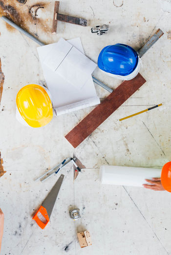 High Angle View Of Work Tools On Table At Workshop