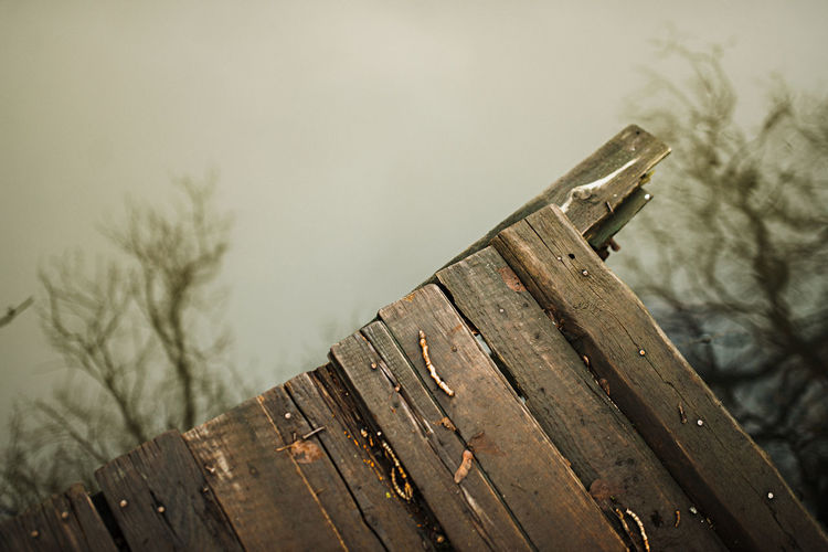 Close-up of wooden fence against sky