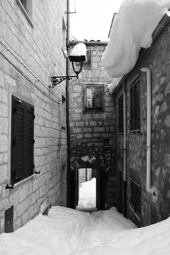 Architecture Building Exterior Built Structure Lighting Equipment Snow Cold Temperature No People Winter House Street Day Window Outdoors Brick Wall - Building Feature Street Light Electric Lamp Alley Snowing Blackandwhite B&w b&w street photography Sicily Palermo Old Town
