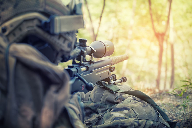 Close-Up Of Sniper On Field