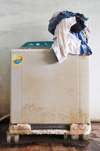 Heavy duty washing machine. Rusty Gray Color Washing Machine Clothes Overwhelmed Household Like A Mountain No People