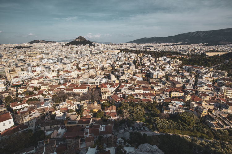 Acropolis Athens Greece Athens, Greece Acropolis Architecture Building Exterior Built Structure Residential District Building Sky City Crowded Cloud - Sky Crowd Cityscape Nature Mountain Community High Angle View Day Town House Roof Outdoors TOWNSCAPE
