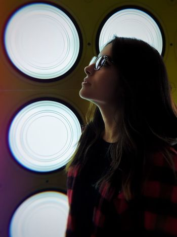 iPhone X IPhoneography White Color Arcade Machine Lights And Shadows Real People One Person Indoors  Lifestyles Leisure Activity Women Circle Young Women Side View Portrait Geometric Shape Casual Clothing
