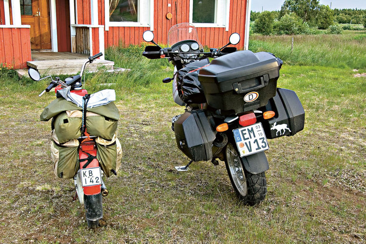 A Moped And A Motorcyckle Always Forward Day Finland And Germany Heading Northpole Let´ Get Goingi No People On The Raod Outdoors Technology The Life Is Not Fair Togetherness Unfrairness