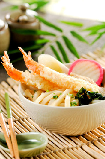 Close-up of seafood in basket on table