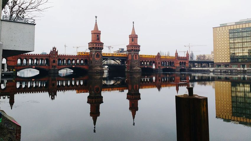 Reflection Water Travel Travel Destinations Sky City Symmetry Business Finance And Industry Sunset Building Exterior Built Structure Architecture Outdoors No People Cityscape Bridge - Man Made Structure Tree Nature Day Oberbaumbrücke