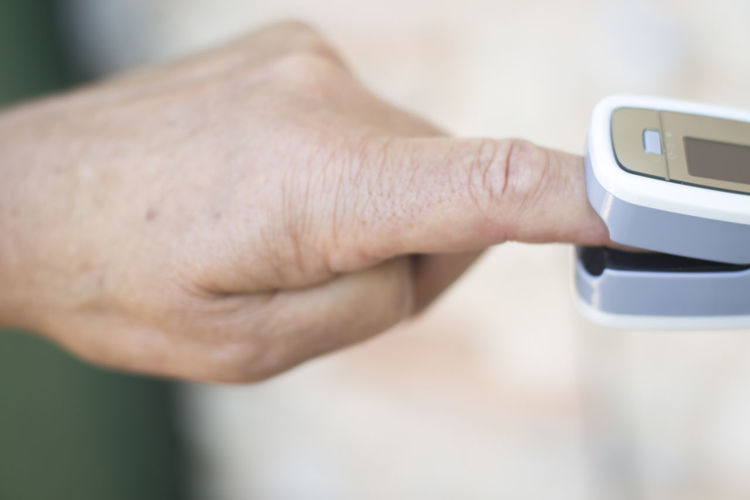 Cropped hand checking blood pressure at home