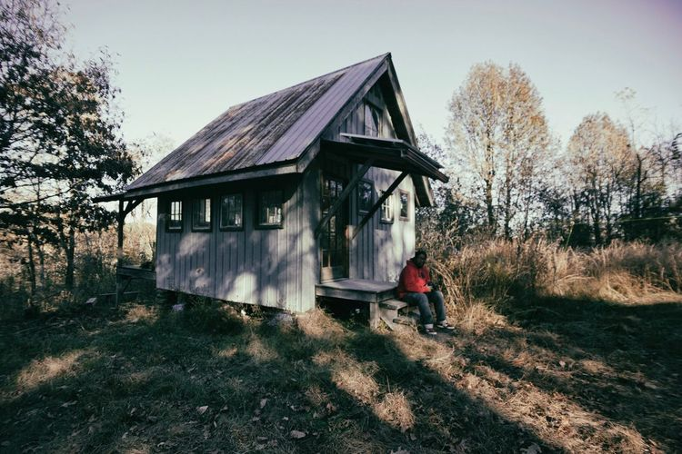 Cabin in the woods Tree Architecture Built Structure One Person Real People Day Outdoors Building Exterior Full Length Clear Sky Sky Nature People