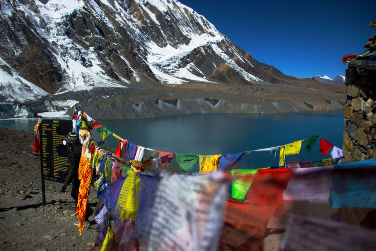 EyeEmNewHere Tilicho Lake 4919m One Of The Most Exciting Trip . Multi Colored Hanging Flag Outdoors Bunting Day Beauty Water Close-up Sky