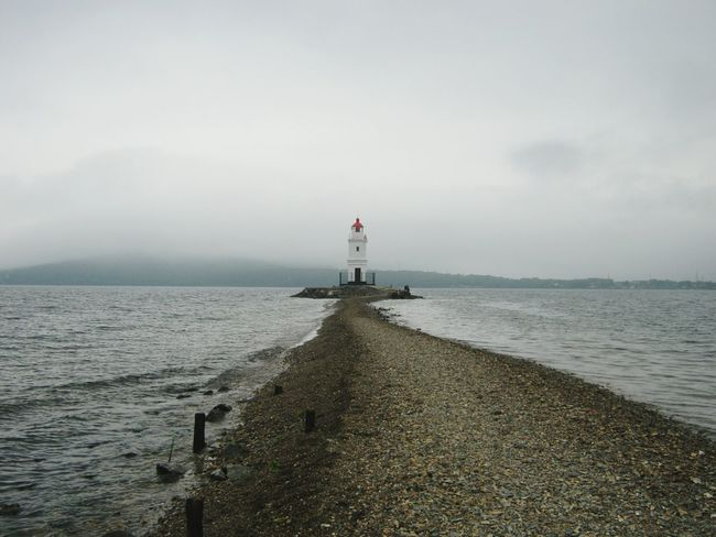 Lighthouse in a misty day Lighthouse Sea Outdoors Beach Day Horizon Over Water Tranquility Travel Destinations Building Exterior No People Water Sky Nature токаревский Tokarevskiy Mist