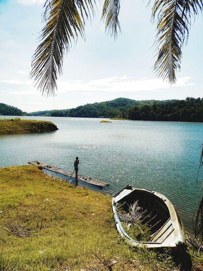 harmony Indonesia Photography  EyeEm Selects INDONESIA Eye4photography  Jogja Landscape Natural Water Tree Lake Standing Beach Men Sky Lakeshore Fishing Tackle