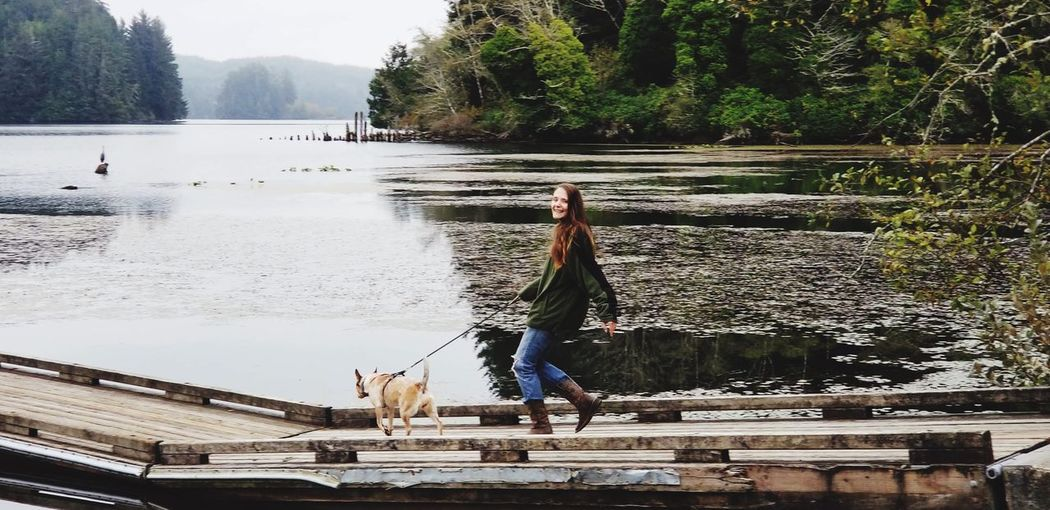 Woman and dog walking on river in Pacific Northwest coastal mountains Water Reflections No Edit/no Filter Travel Photography EyeEm Animal Lover EyeEm Best Shots Eyeem Dog World OFFICIAL Photos Club 🐶🌍😄👍 River Mountains Mountain River Oregon Tree Real People Plant Water Nature Day Lifestyles One Person Full Length Mammal Leisure Activity Architecture Built Structure Outdoors