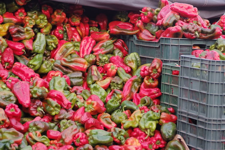 Red and green bell peppers for sale at market stall
