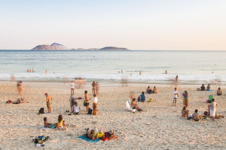 à la plage | Ipanema Beach Beach Beach Holiday Clear Sky Enjoyment Horizon Over Water Leisure Activity Outdoors Relax Relaxation Scenics Simple Life Tranquil Scene Unrecognizable Person Vacations Weekend Activities The Street Photographer - 2017 EyeEm Awards The Great Outdoors - 2017 EyeEm Awards