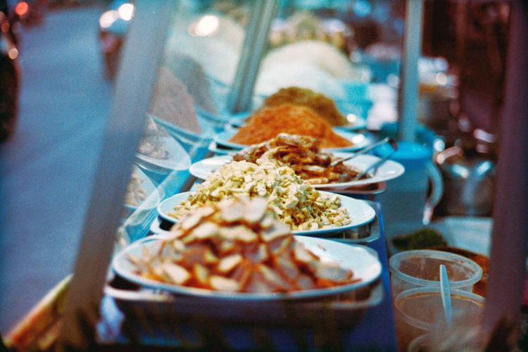 Focus topping, Pad Thai Restaurant on street food, Thailand, film photo Film 35mm Film 35mm 35mmfilmphotography EyeEm Best Shots Food Delicious Thailand Asian  Season  Market Business Lifestyle Shopping ♡ Popular Food And Drink Food Ingredients Topping Travel Night Street Night Background Thai Pat Cook  Yummy Tasty Street Food Street Market Market Stall