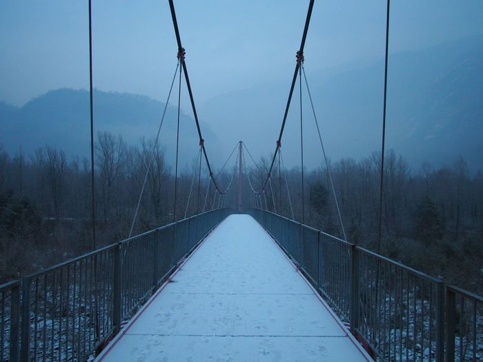 Bridge - Man Made Structure Built Structure Connection Day Mountains Nature No People Outdoors Sky Snow Suspension Bridge The Way Forward Tree