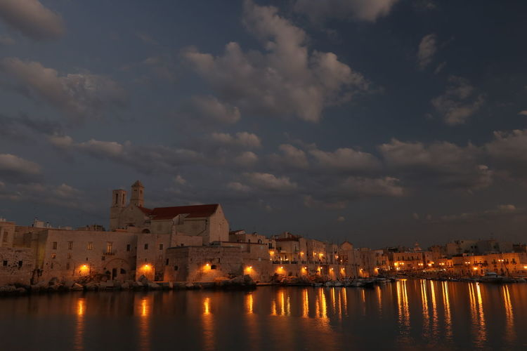 Cloud - Sky Building Exterior Sky Architecture Water Built Structure Building Reflection Nature No People Waterfront Illuminated History The Past Travel Destinations City Outdoors Sea Apulia Italy Italia Puglia Giovinazzo Giovinazzo Architecture