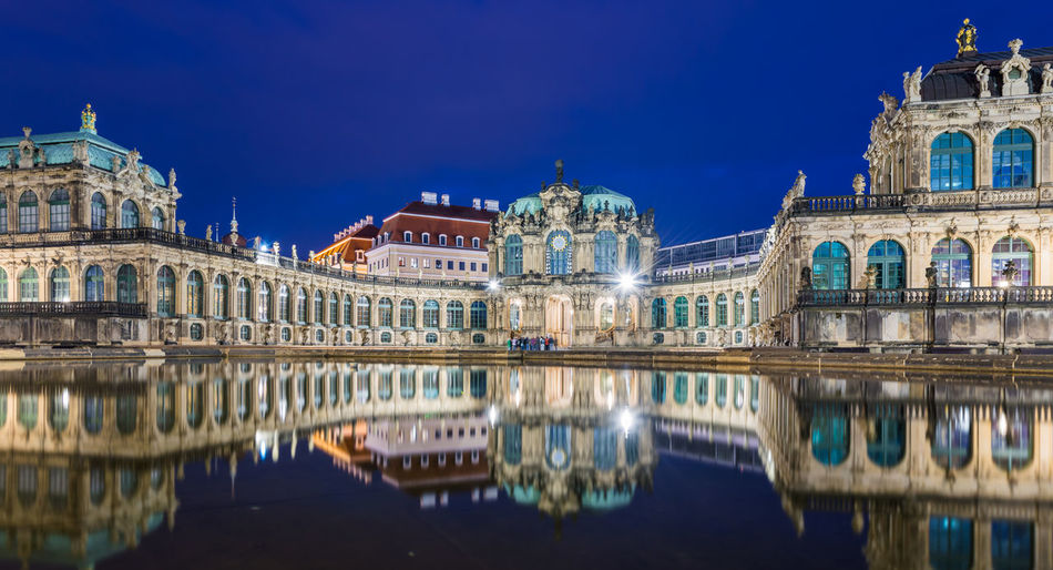 DRESDEN, GERMANY - 17 JUNE, 2015: Zwinger museum in Dresden, Germany on 17 JUNE, 2015 Architecture Blue Building Exterior Built Structure Capital Cities  City City Life Dome Façade Famous Place History Illuminated International Landmark Pediment Place Of Worship Reflection Sky Spire  Standing Water Tall - High Tourism Travel Travel Destinations Water Waterfront