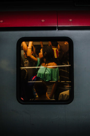 Framed Portrait Mode Of Transportation Indoors  Lifestyles Transportation Women Rear View Glass - Material Leisure Activity Adult One Person Real People Vehicle Interior Motor Vehicle Car Land Vehicle Reflection Technology Sitting Casual Clothing The Art Of Street Photography Streetphotography The Street Photographer - 2019 EyeEm Awards