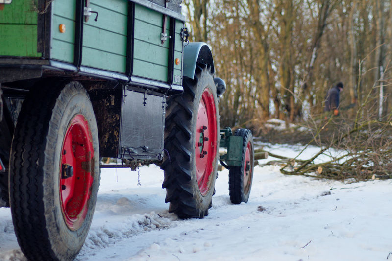 Burning Wood Cold Temperature Day Land Vehicle Lieblingsteil Nature No People Outdoors Snow The City Light Tire Tractor Transportation Tree Winter Wood