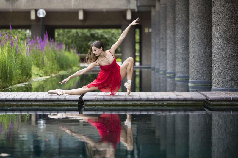 Woman ballet dancing at pond