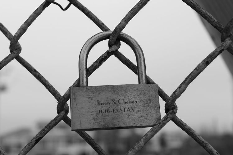 Close-up of padlocks on fence