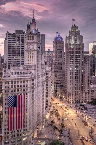 The giant Independence Day flag in this shot is covering the Wrigley tower in Chicago. Harking back to simpler times and the great post war boom of the roaring twenties the Wrigley tower (completed 1921) was built by chewing gum magnate William Wrigley Jr and is a fusion of french renaissance and spanish revival architectural styles. The neo-Gothic building across the road is the Tribune Tower (completed 1925) which was built to house the Chicago Tribune Newspaper. Love Life, Love Photography Architecture Chicago Chicago Skyline Chicago Architecture Gothic Architecture High Rise USA Architecture Building Building Exterior Built Structure Chicago Illinois City Cityscape Cloud - Sky Modern Office Office Building Exterior Sky Skycraper Skyscraper Street Street Photography Tall - High Tower