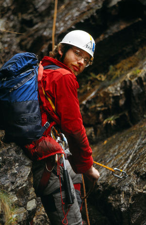 Climber on belay in Clachaig gully, Glencoe, Scotland. Adventure Helmet Activity Climbing Extreme Sports Rock Safety Sport Real People One Person Leisure Activity Rock - Object Rope Rock Climbing Safety Harness Outdoors Clachaig Gully Glencoe Scotland 1982 Rucksack Millet Carabiner Piton Belay