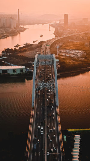 High angle view of bridge over river at sunset in guangzhou