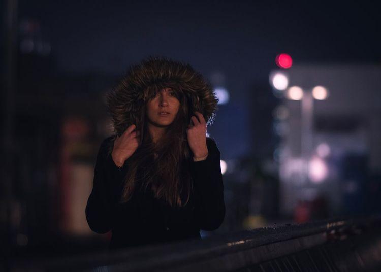Young Woman Wearing Fur Hood At Night