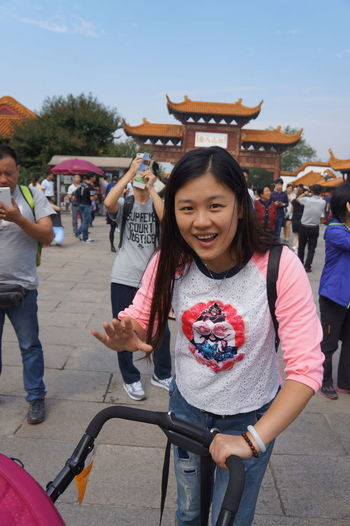 Chinese young mother portrait Baby Stroller Baby ❤ Casual Clothing Chinese Chinese Mother Chinese Words Enjoyment Front View Fun Happiness Leisure Activity Looking At Camera Outdoors Outside Person Portrait Smiling Standing Toothy Smile Young Adult Young Women