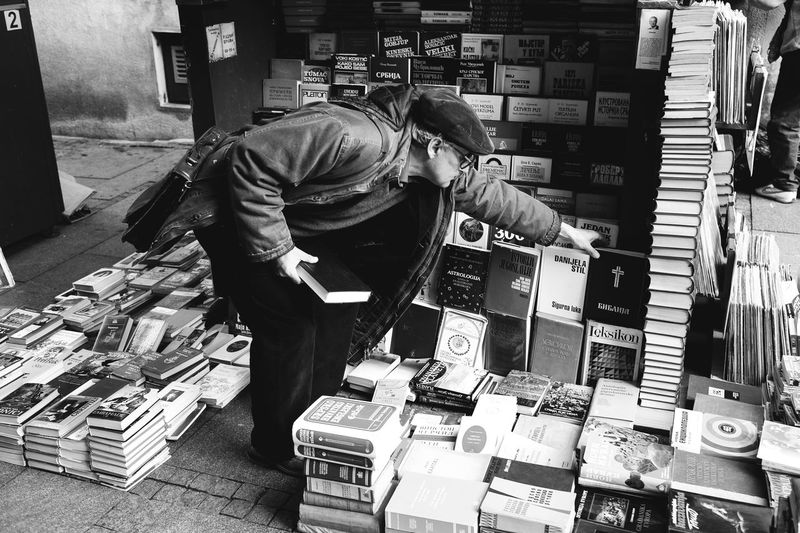 Reaching for faith Adult Bible Books Casual Clothing Day Large Group Of Objects Library One Person People Price Tag Research Retail  Small Business Stack Standing Store The Street Photographer - 2017 EyeEm Awards