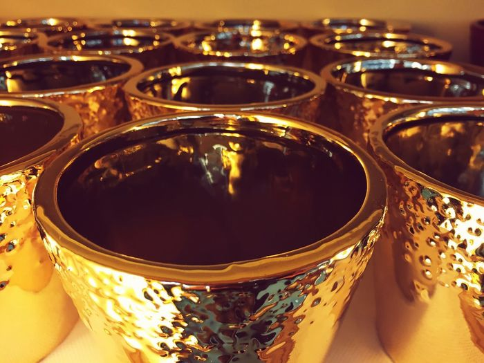 golden pots Stylish Golden Color Pot Close-up Indoors  No People Still Life High Angle View Table Reflection Pattern Container Design In A Row Arrangement Household Equipment
