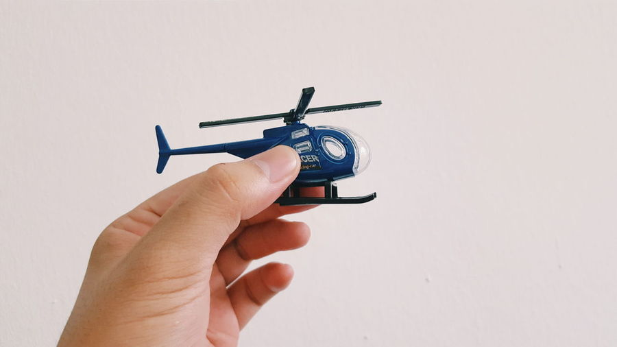 Action Figure Close-up Cropped Diecast Helicopter Holding Human Finger Lifestyles Miniature Model Part Of Person Toy Unrecognizable Person Festival Season
