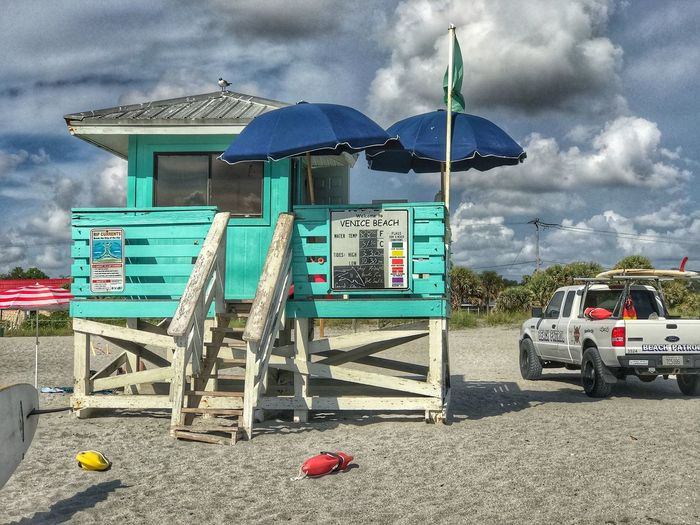 Save Cloud - Sky Sky Day Transportation Nature Architecture Mode Of Transportation No People Built Structure Outdoors Land Building Exterior Land Vehicle Motor Vehicle Road Text Beach Sign Hut