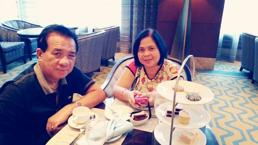Dad and Mom having their afternoon tea.