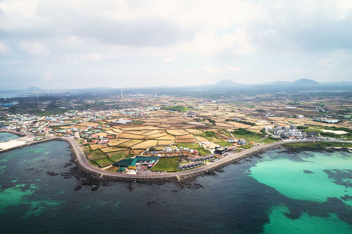 Drone  Jeju Aerial View Architecture Building Building Exterior Built Structure City Cityscape Cloud - Sky Day Dronephotography High Angle View Jejuisland Nature No People Outdoors Scenics - Nature Sea Sky Summer Swimming Pool Water Waterfront