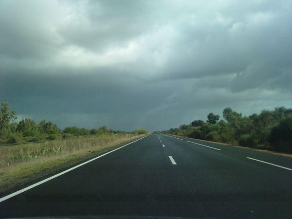 Road Road Highway The Way Forward Wet Cloud - Sky Outdoors Landscape No People Fog Storm Cloud Torrential Rain Night Tree Area Sky Nature Hurricane - Storm Cyclone