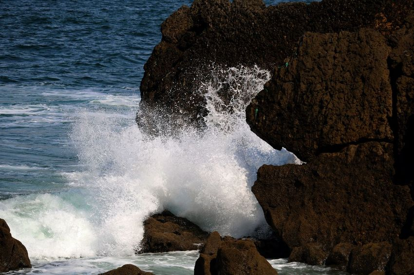 Outdoors Nature Beauty In Nature Beach Water Ocean Motion No People Power In Nature Forces Of Nature Portugal Day Rock Rock - Object Rock Formation Wave Waves Waves, Ocean, Nature Splashing Splashing Water Force Amazing Nature Close-up Details Of Nature Crashing Waves  Sea Solid Power Scenics - Nature Breaking Hitting Flowing Water