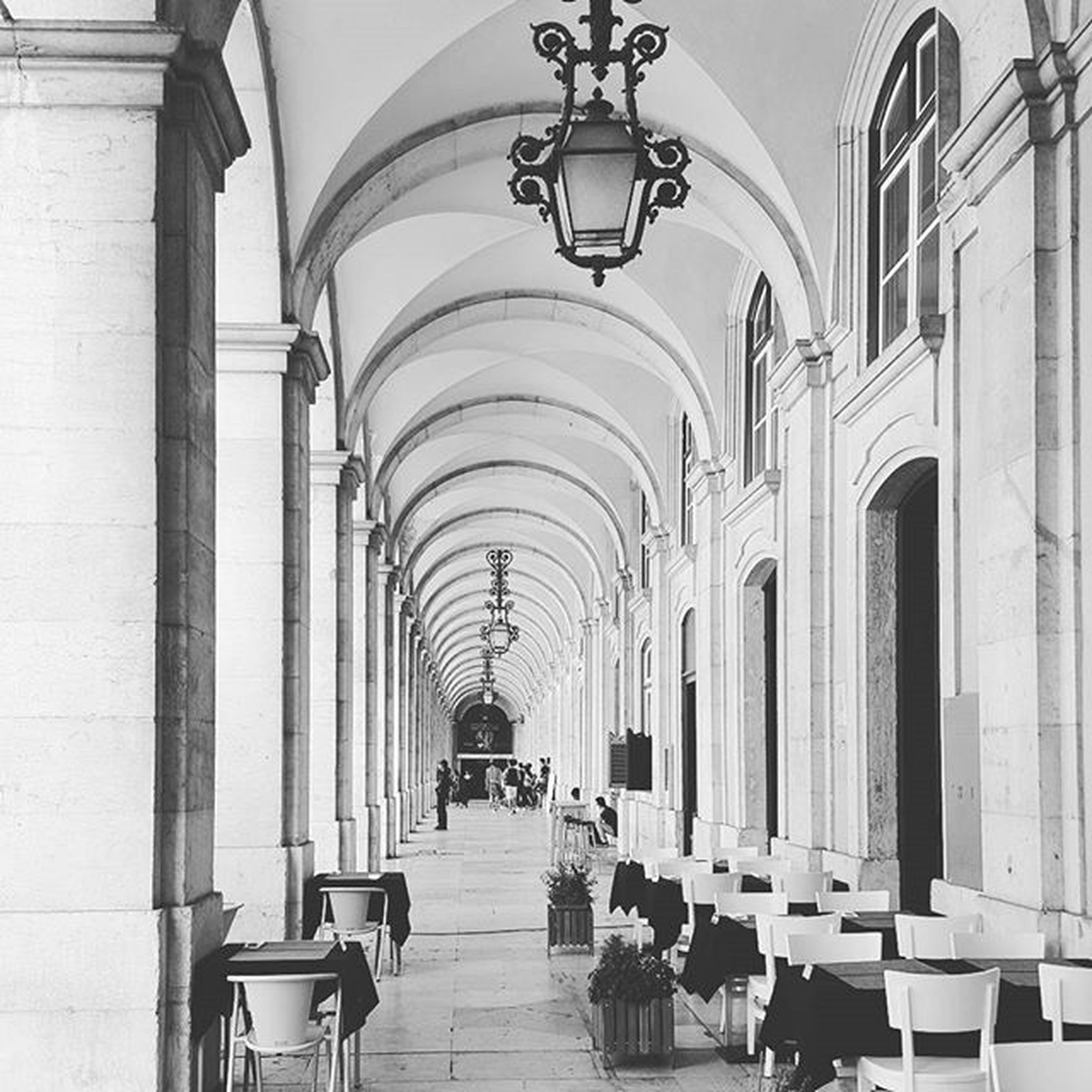 indoors, arch, architecture, the way forward, built structure, corridor, ceiling, in a row, diminishing perspective, place of worship, architectural column, religion, incidental people, colonnade, empty, tiled floor, person, flooring, archway, travel destinations