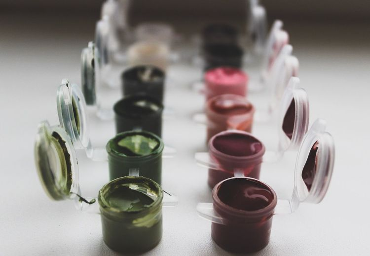 Close-up of watercolor paints in containers on table