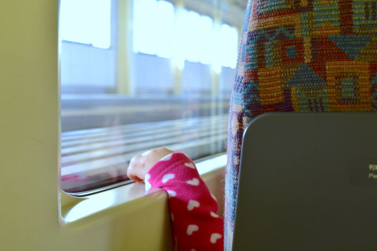 Low Angle View Station Small Hand Pretty Child Travel It's About The Journey Window Day Transportation Close-up Train Rail Transportation Window Frame Selective Focus Childhood Hand Journey Departure Challenge Pink Color