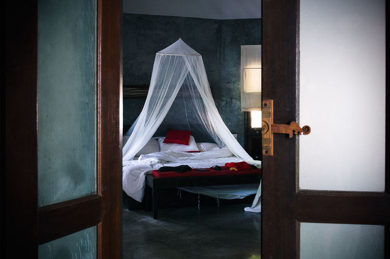 Secret island hideaway at the thai beach of haad yuan Architecture Beautiful Building Hideaway Holiday Holidays Hospitality Island Refuge Resort Secret Service Thailand Vacation Vacation Time Bed Bedroom Canopy Soft Light Open Door Mosquito Net Concrete Bedding Seductive The Secret Spaces